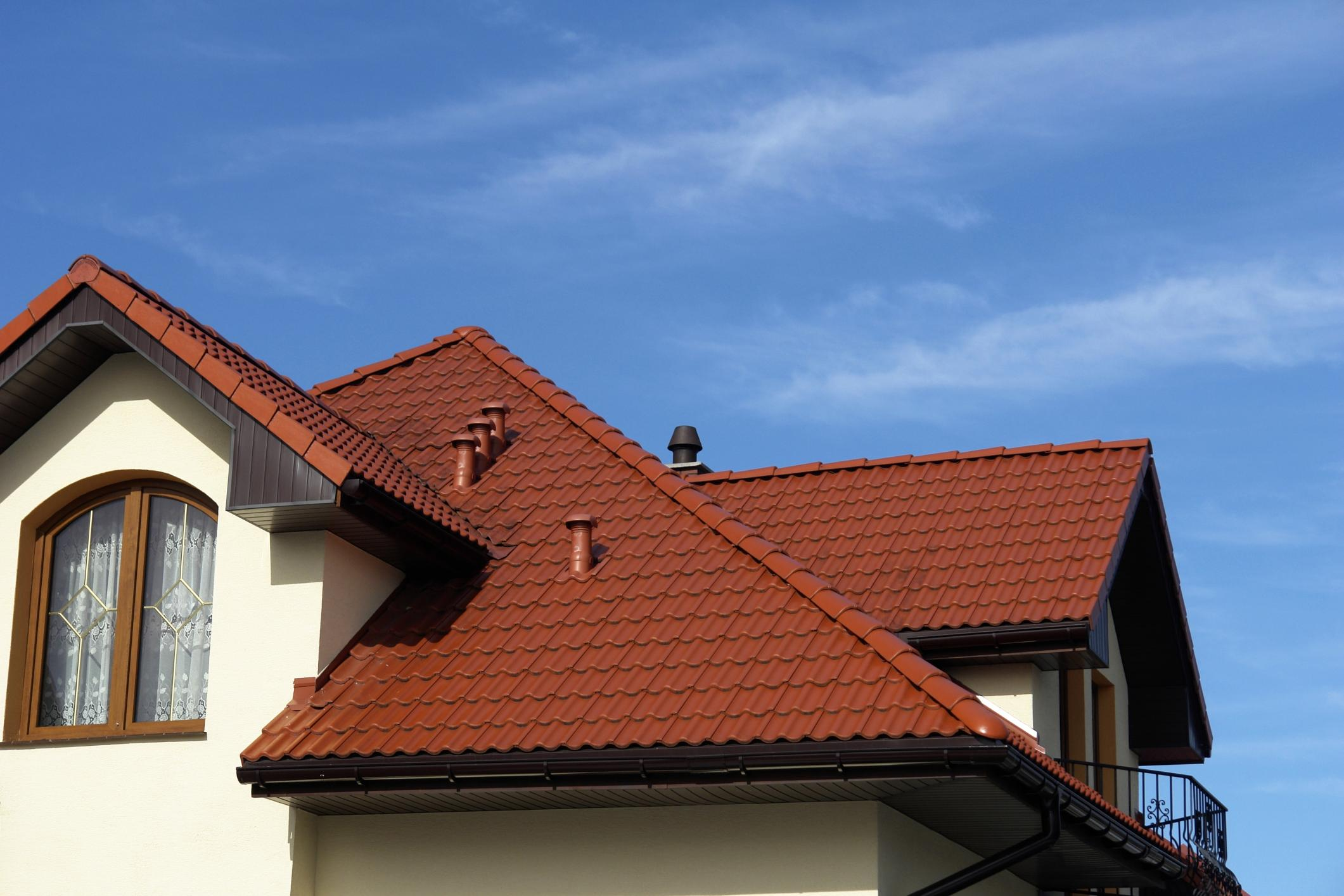 Home with brown roof and blue sky